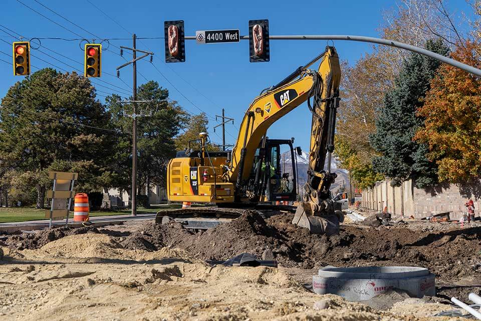 Excavators rebuilding new storm drains for improved storm water drainage
