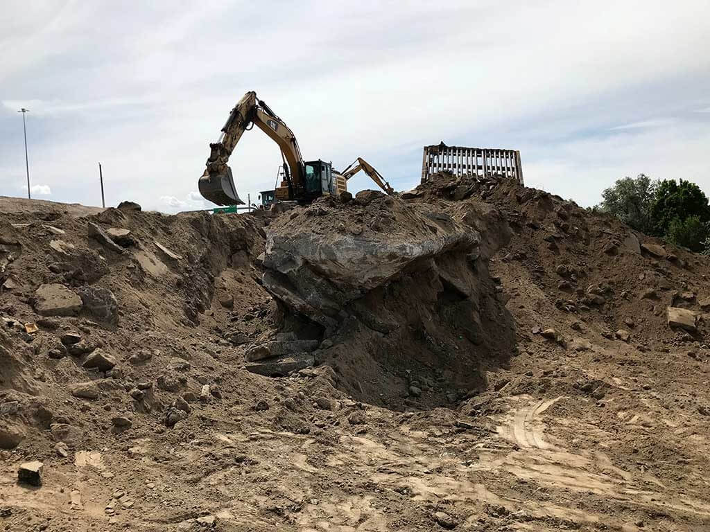 removing concrete from old dump site