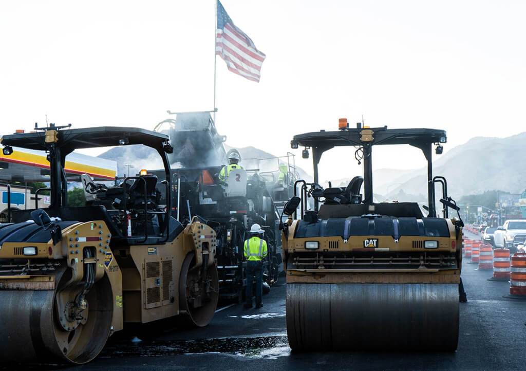 The American flag flys in the morning breeze as Geneva Rock prepares to pave roads in Logan, Utah