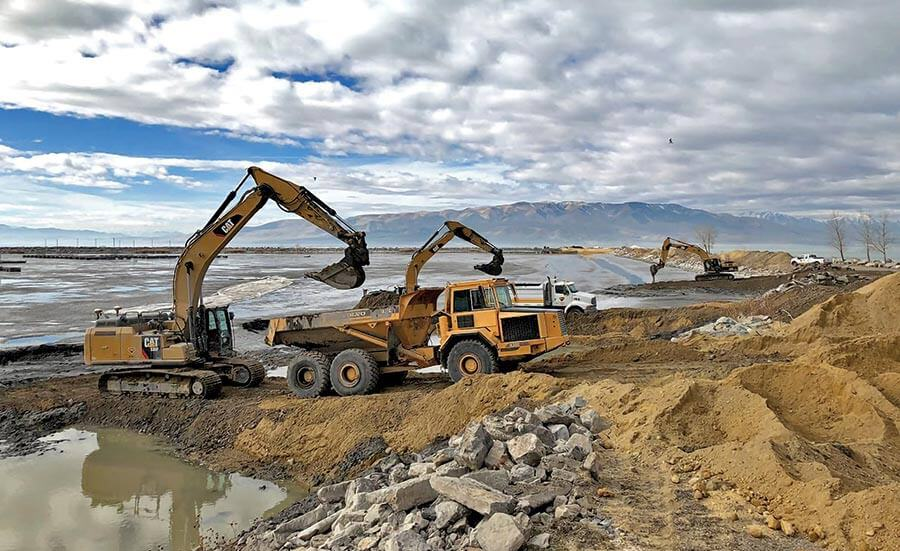 Dredging Provo Marina with multiple track hoes and dump trucks