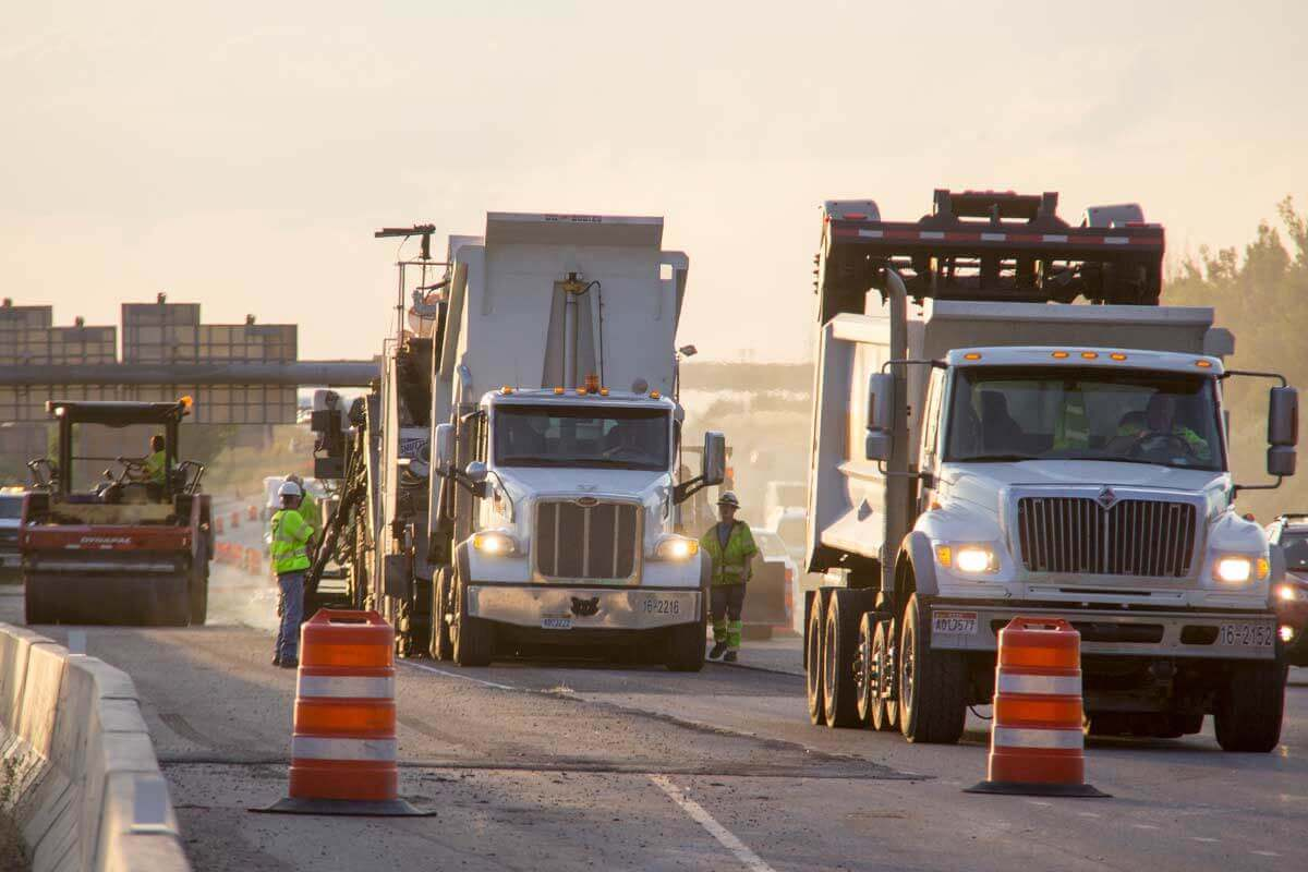 Dump Trucks delivering hot mix asphalt to I-15