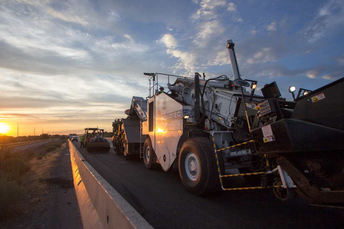 Spray paver sealer asphalt installation on I-15 near Davis county